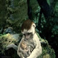 обезьянка с динозавриком
